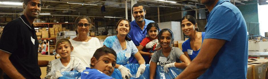 Volunteers working in the warehouse of the FoodBank