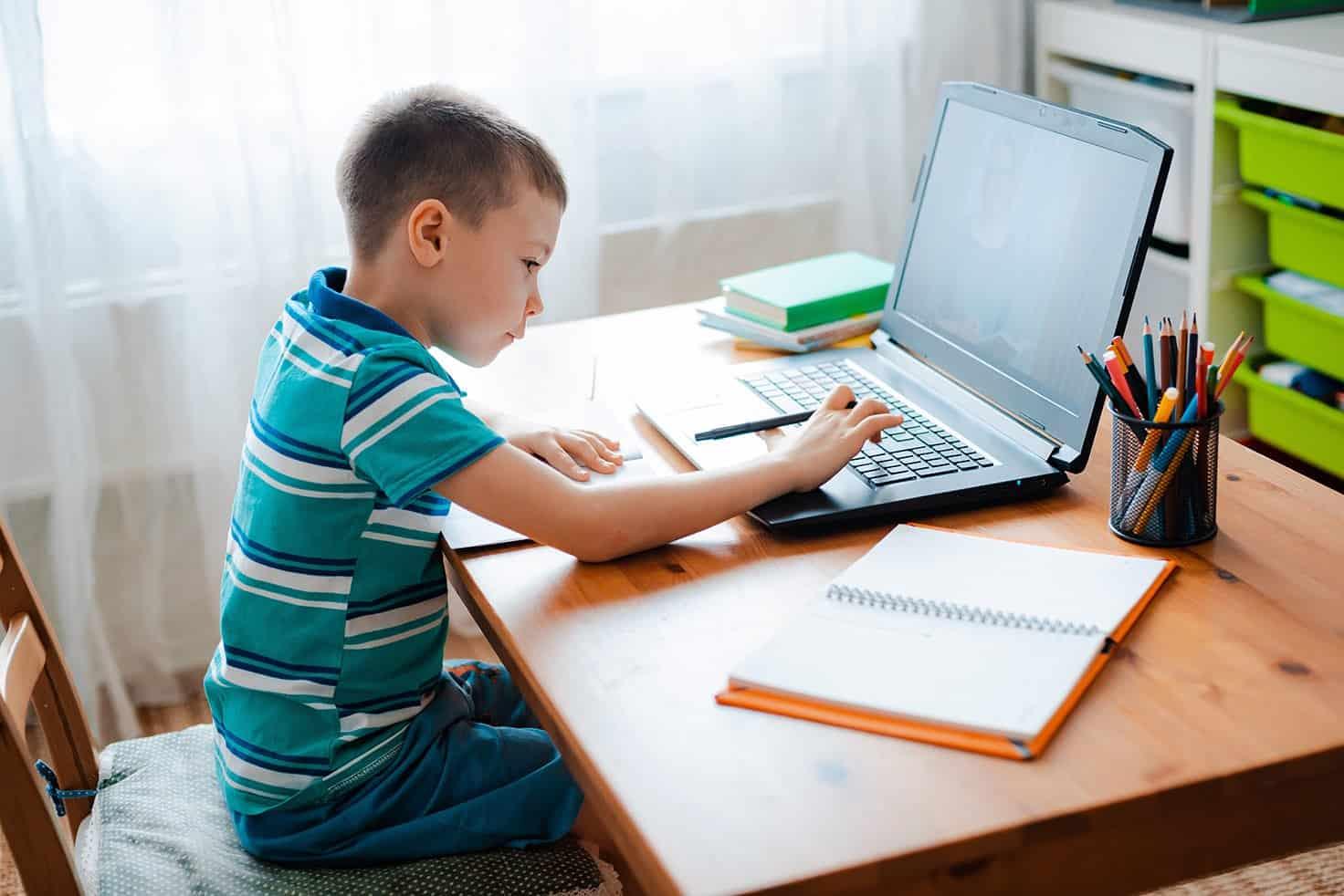 Child sitting at desk doing homework