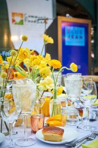 Table setting featuring yellow flowers and a blue background