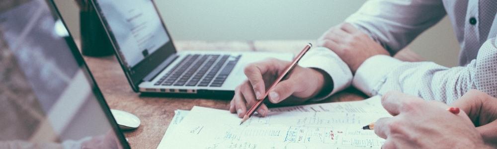 People sitting at laptops taking notes